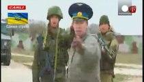 Tensions persist in Crimea as Ukrainian troops challenge Russians