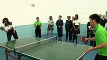 First lady Michelle Obama visits high school in China, plays ping pong