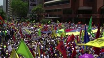 Thousands hit streets in new Venezuela protests, tear gas fired