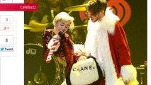 SpinMedia - Miley Cyrus Debuts A New Haircut and Gets All Freaky with Santa Claus at Jingle Ball