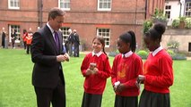 PM plants poppies with school children at Downing Street