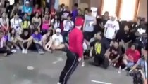 great dancing stunt competition between little kid and young guy very interesting .
