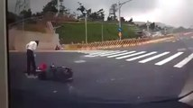 Amazing Scooter crash  : driver falling in manhole!