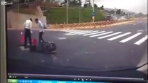 Motorcyclist crashes off bike and then disappears down a hole in the road - YouTube