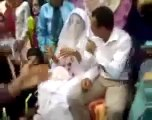 groom hit her bride during marriage ceremony.