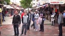 Kuşadası'na Hem Yağmur, Hem Turist Yağdı
