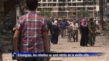 Syrie: les habitants retrouvent leurs maisons dévastées à Homs