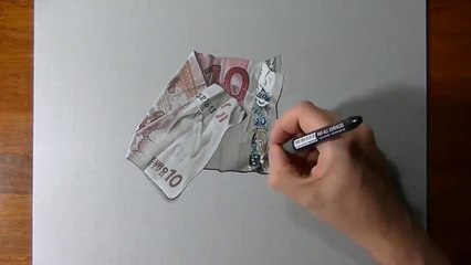 L'incredibile disegno in 3D dei 10 Euro su un foglio di carta