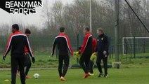 Wayne Rooney nutmegs manager David Moyes at Man United training