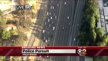 Amazing Police Chase - Suspect tricks police by taking off coat and walking away