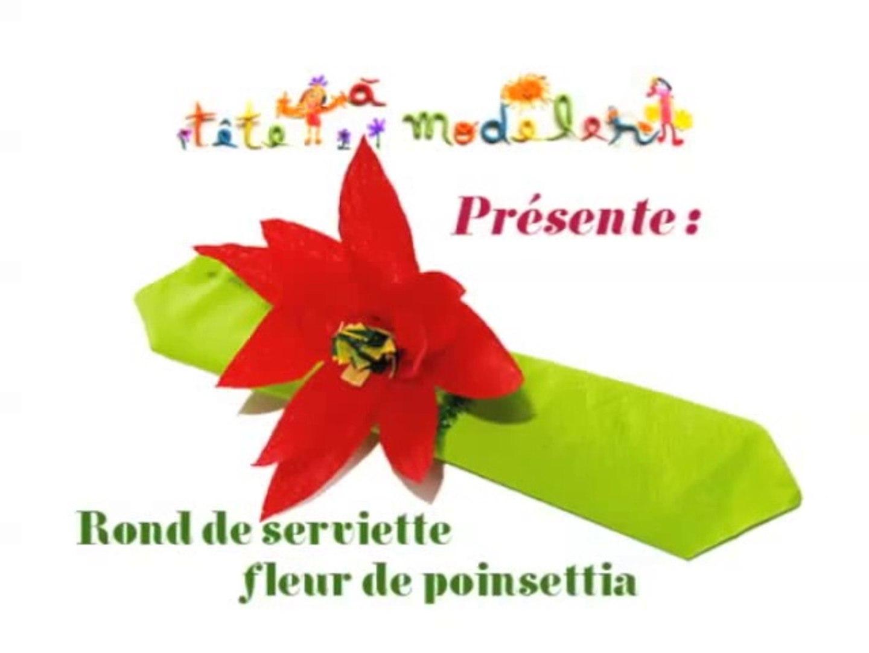 Rond De Serviette A Fabriquer Pour Noel rond de serviette décoré d'une fleur poinsettia