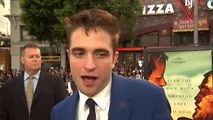 NTDTV: Robert Pattinson and Guy Pearce walk the red carpet at the Los Angeles Premiere of 'The Rover'