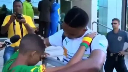 Samuel Eto'o ignores all media and goes stright to a young Cameroon.fan