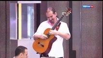 Solo de guitare électrique joué avec une guitare sèche