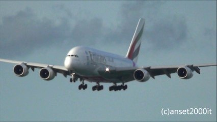 Airbus A380 Emirates Airlines. Hong Kong Airport Landing and Takeoff in the Sunset