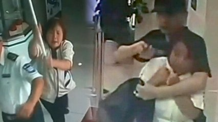 Mop-Wielding Cleaning Lady Takes on Armed Robber