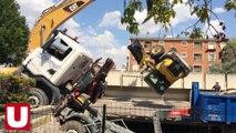 Une pelleteuse relève un engin de chantier effondré dans un parking souterrain à Reims