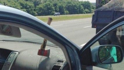 Random Flying Hatchet Smashes Car's Windshield on Highway