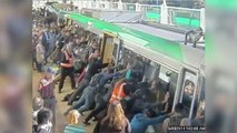 Australian Commuters Tip Train Car to Free Trapped Man