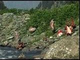 Sadhus bathe in a stream en route Amarnath, Kashmir
