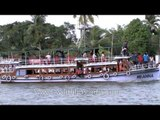 Tourists take a boat ride during Champakulam Boat race - Alleppey
