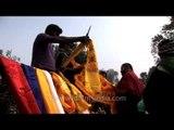 Man sells prayer flags during 32nd Kalachakra in Bodhgaya