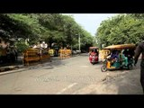 Electric rickshawalas waiting for their passengers at Sarojini Nagar