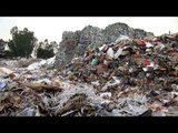 Compacted recyclable paper waste at a recycling plant in India