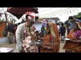 Groom's mother performing rituals of 'baraat' ceremony : Kumaoni wedding
