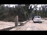 Crossing damaged roads on the way to Dehradun through Rajaji National Park