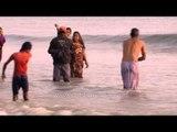 Hindus gather to take a holy dip at Ganga Sagar