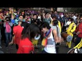 Gay participants dancing in the streets: Delhi Queer Pride