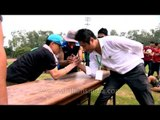 Wrestlers grip each other at arm wrestling competition : At 50th Naga Fest'13