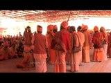 Naga sadhus waiting for prasad at Navaratri Bhandara in Varanasi