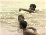 Kids splashing around in the waters of Yamuna River, Delhi
