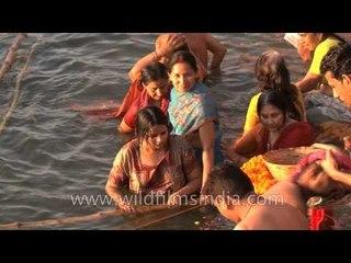 Hindu women bathe in the Ganges to observe Shivratri, Varanasi