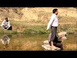 Men feed fish and eels near Sariska