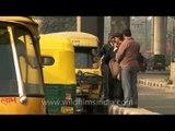 Auto-rickshaws line up outside Govindpuri metro station, Delhi