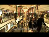 Time lapse of people taking the escalator at Select citywalk, Delhi