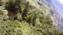Wingsuit flight in the Alps, so so close to the trees!