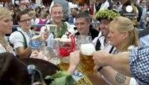 Rain pours, beer flows as Munich Oktoberfest begins