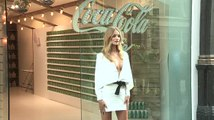Rosie Huntington Whiteley Enjoys A Coca Cola Life
