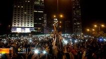 Protests grow amid celebrations in Hong Kong