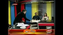 Mubashir Lucman Distributing Sweets during a Live Show on Javed Hashmi's Defeat