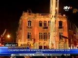 Cae cornisas y parte del frontis del edificio de la plaza Dos de Mayo
