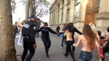 Riot policeman hits wall headfirst when confronted with dozens of topless Femen protesters