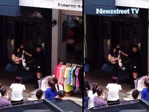 Female shoplifter stripped naked on street