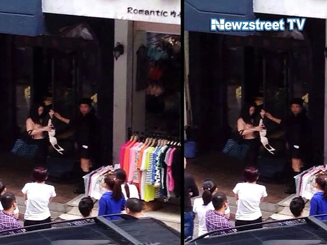Female shoplifter stripped naked on street