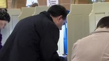 Walker and Burke cast votes in tight race for governor in Wisconsin