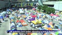 Hong Kong protest leaders prevented from flying to Beijing